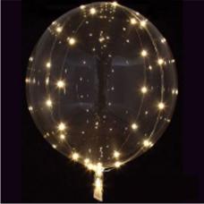 Svietiaci balón priehľadný s bielym svetlom